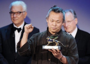 Kim Ki-Duk with the Golden Lion award for Pieta at the 69th Venice Film Festival